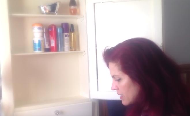 woman-organizing-bathroom